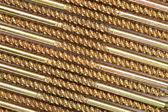 Sector of golden screws — Stock Photo