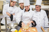 Culinary students learning how to mix dough — Stock Photo