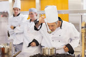 Chef tasting his students work — Stockfoto