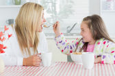 Girl feeding her mother — Stock Photo