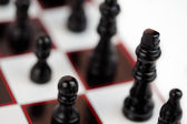 Black chessmen standing — Stock Photo