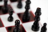 Black chessmen standing — Stock Photo
