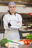Chef standing beside chopping board and vegetables — Stock Photo