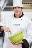 Smiling chef mixing with whisk — Stock Photo