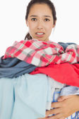 Woman overwhelmed with amount of dirty laundry — Stock Photo
