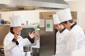 Head chef scolding employees — Stock Photo