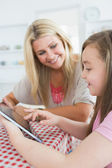 Woman and daughter holding a tablet pc — Stock Photo