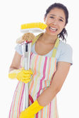 Distressed woman holding cleaning tools — Stock Photo