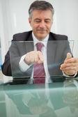 Smiling man touching on a virtual screen — Stock Photo