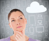 Woman with hand on chin thinking about cloud computing — Stock Photo