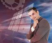 Businessman standing smiling with holographic number pad — Stock Photo