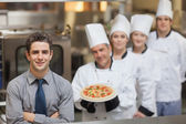 Waiter standing in front of Chef's — Stock Photo
