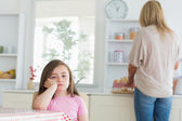 Little girl bored in the kitchen — Stock Photo