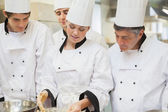 Trainee Chef's learning how to mix dough — Stock Photo