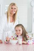 Girl having cereal for breakfast — Stock Photo