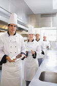 Team of Chef's presenting deserts — Stock Photo