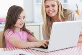 Little girl typing on laptop — Stock Photo