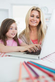 Mother watching child typing — Stock Photo