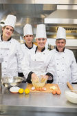 Smiling culinary students with pastry teacher — Stock Photo