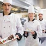 Chef's presenting deserts — Stock Photo