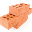 Four red bricks stacked as a part of a wall — Stock Photo