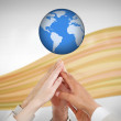 Reaching hands to the globe — Stock Photo