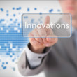 Businessman standing while pointing to the word innovation — Stock Photo #23110352
