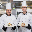 Stock Photo: Male Chef's presenting their dishes
