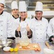Stock Photo: Culinary class with pastry teacher giving thumbs up