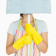 Young woman hiding behind mop  — Stock Photo