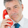 Smiling man using the phone — Stock Photo