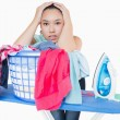 Stock Photo: Womfed up with ironing