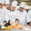 Stock Photo: Pastry chef showing students how to prepare dough