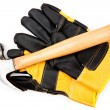Hammer lying on two leather gloves — Stock Photo