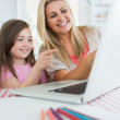 Woman and girl at the laptop and pointing — Stock Photo #23112314