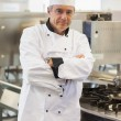 Stock Photo: Chef leaning at stove