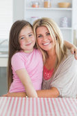 Girl sitting on mother's lap — Stockfoto