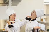 Two Chef's joking in the kitchen — Stock Photo