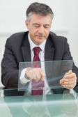 Business man scrolling on a virtual screen — Stock Photo