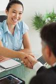 Smiling businesswoman shaking man's hand — Stock Photo