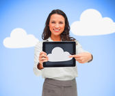 Woman standing holding a tablet pc showing cloud computing symbo — Stock Photo