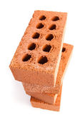 Four clay bricks being stacked — Stock Photo