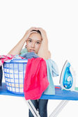 Woman getting frustrated from amount of ironing to do — Stock Photo