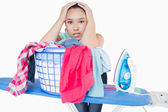Woman fed up with ironing — Stockfoto