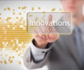 Businessman pointing to the word innovations — Stock Photo