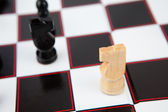 Chess pieces on the board — Stock Photo
