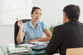 Businesswoman talking with a man — Stock Photo