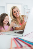 Woman and girl at the laptop and pointing — Stock Photo