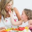 Daughter feeding her mother — Stock Photo