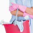 Cleaner holding a pink bucket — Stock Photo #23486353